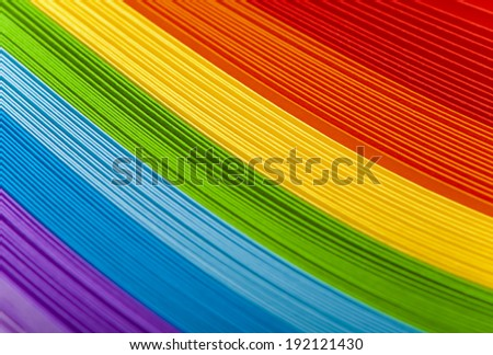 Colorful card stock in unique elliptical shapes with shadow effect and selective focus on a black background - stock photo