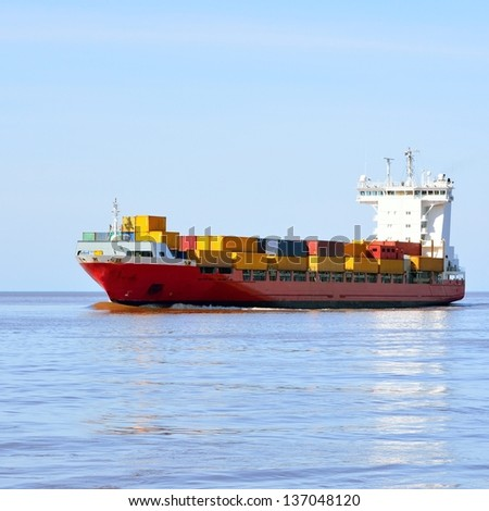 colorful cargo container ship sailing