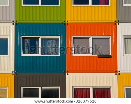 colorful cargo containers used as home by students to  solve housing problem - stock photo