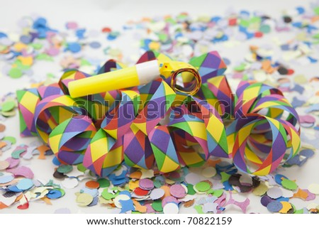 Colorful carnival background with stripes and whistle;