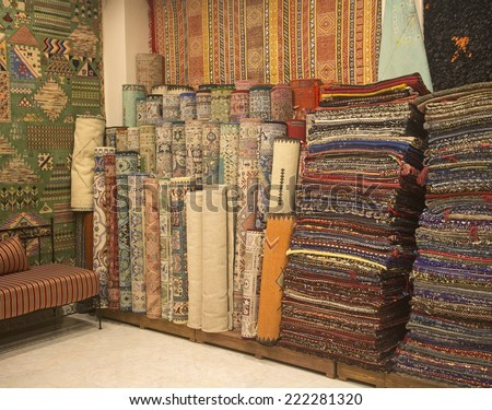colorful carpets of the medina in marrakesh - stock photo