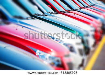 Colorful Cars Stock. Cars For Sale. Dealer Lot Cars Row. - stock photo