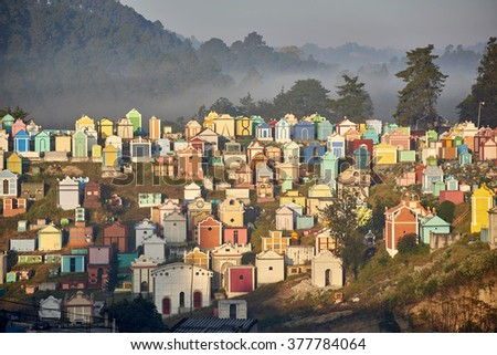 Colorful Cemetery in Chichicastenango , Guatemala - the picture from February 3rd 2016 shows the famous Chichicastenango cemetery where family members paint the tombstone - stock photo
