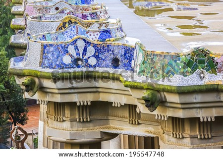 Colorful ceramic bench in Park Guell. Park Guell (1914) is the famous architectural town art designed by Antoni Gaudi. Barcelona, Spain. - stock photo