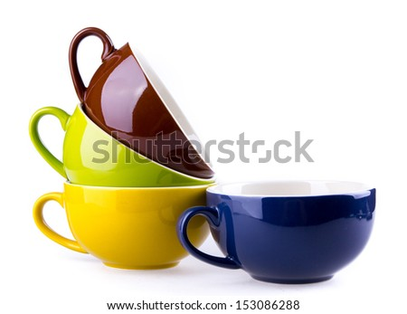 colorful ceramic cup on white background - stock photo