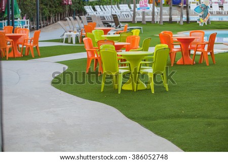 Colorful chairs by the pool
