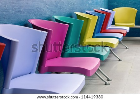 Colorful chairs lined up in a school child - stock photo