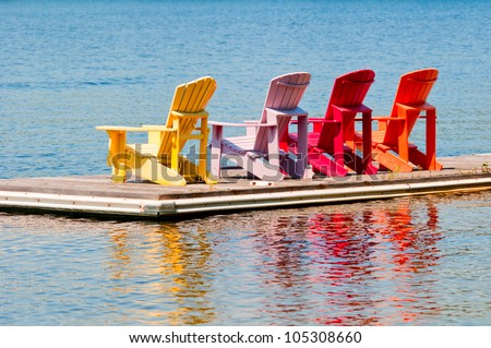 Colorful chairs on a dock - stock photo