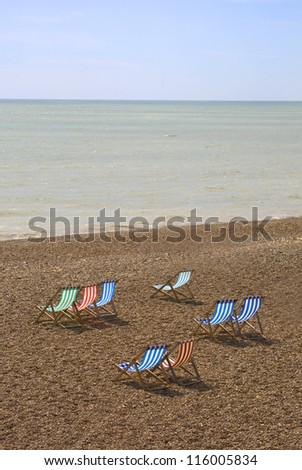 Colorful chairs on Brighton Beach, England - stock photo