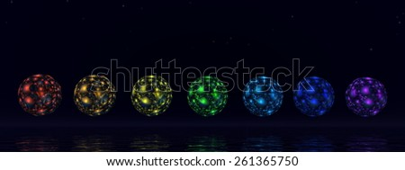 Colorful chakra spheres by night- 3D render