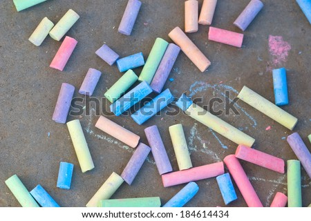 colorful chalk drawing on the pavement - stock photo