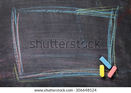 Colorful chalk frame on blackboard background. Top view with copy space - stock photo