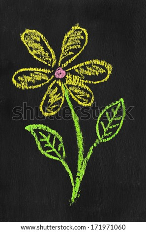 Colorful chalk illustration of flower by kid on blackboard  - stock photo