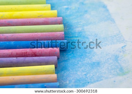 colorful chalk in white paper