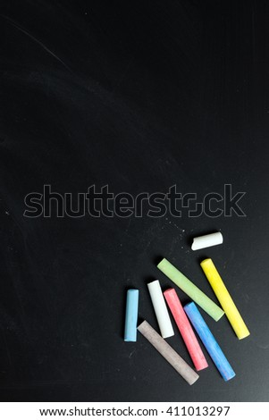 Colorful chalk on chalkboard with blank space for text