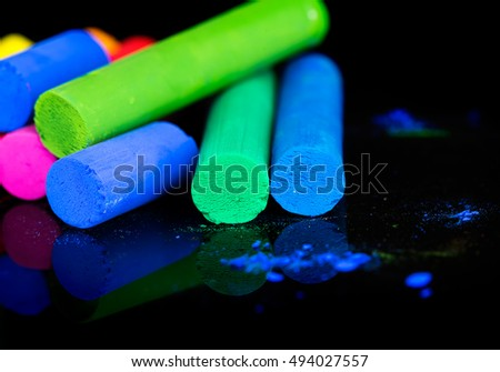 Colorful chalks on black background