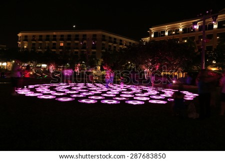Colorful changing lights on discs in Centennial Square on Clematis Street in downtown West Palm Beach, Florida - stock photo