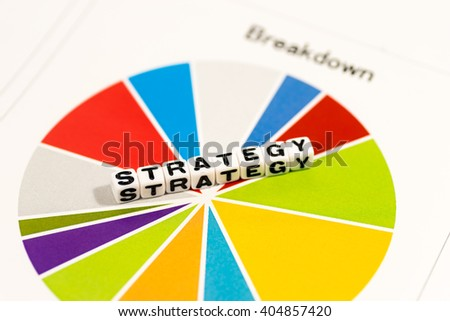 Colorful charts with STRATEGY on white cube - stock photo