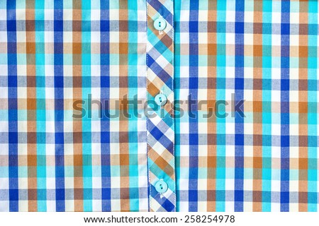 Colorful checkered shirt, shirt fabric plaid texture. Geometric background - stock photo