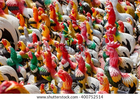 Colorful chicken statues at Wat Jay-Dee temple or Wat i-Kai temple at Nakhon si thammarat, Thailand - stock photo