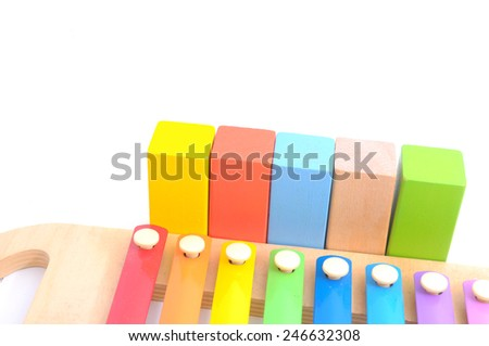 Colorful child wooden xylophone and wooden block isolated on white - stock photo