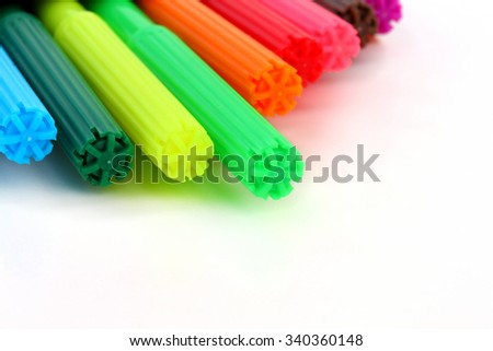 Colorful children felt tip pens on white background - stock photo
