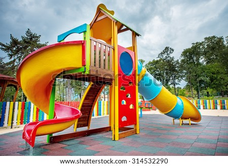 Colorful children playground in the park. - stock photo