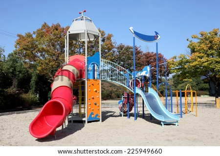 Colorful children playground on park with blue sky - stock photo