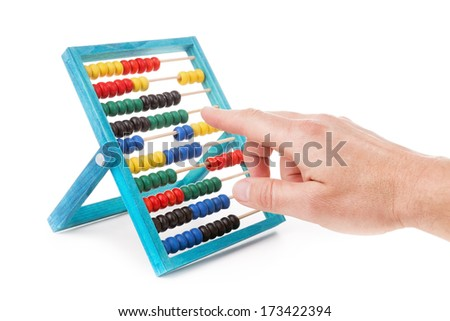 Colorful children's accounts and men hand does the calculations. Accountant on a white background. - stock photo