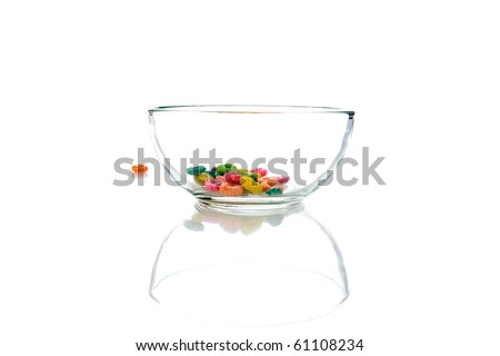 colorful childrens breakfast cereal loops with milk. isolated on white - stock photo
