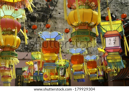 Colorful Chinese Lanterns hung outside a buddhist temple around New Years - stock photo