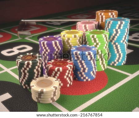 Colorful chips on a green table. Depth of field on some chips. Clipping path on the chips.