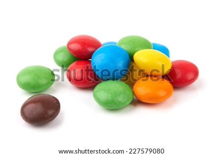 colorful chocolate buttons on a white background  - stock photo