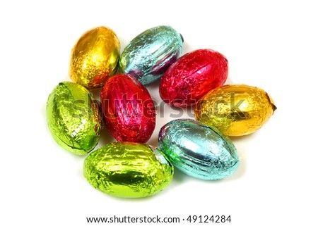 Colorful chocolate Easter eggs over white