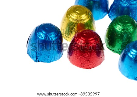 Colorful chocolates isolated on a white background.