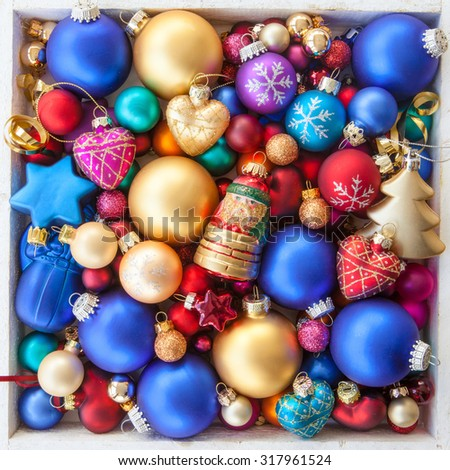 Colorful christmas baubles for a christmas background - stock photo