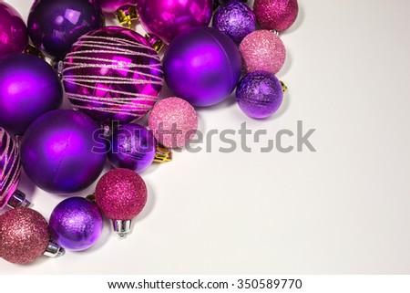 colorful christmas baubles in various shade of purple and pink