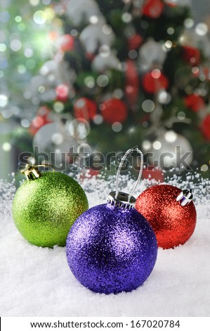 Colorful Christmas baubles on festive background - stock photo