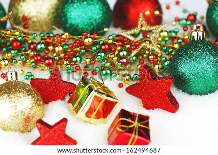 Colorful Christmas decoration and gifts on snow
