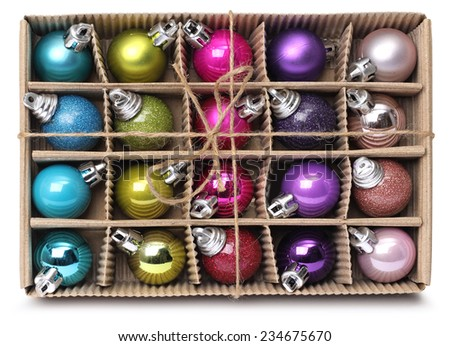 Colorful Christmas decoration balls in cardboard box with ribbon - stock photo