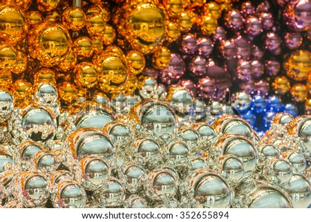 Colorful Christmas decoration baubles on for background and texture, shiny round for party decorate backdrop. Blurred fairy lights background - stock photo