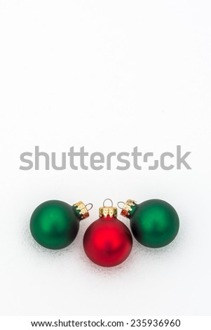 Colorful Christmas decorations isolated in snow