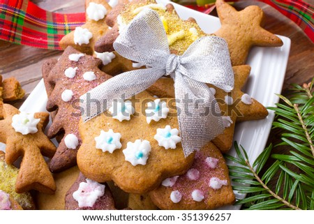 Colorful Christmas gingerbread cookies on wooden background