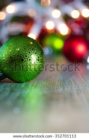 Colorful Christmas ornaments and lights on a wooden background.