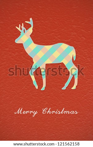 Colorful Christmas reindeer on red background - stock photo