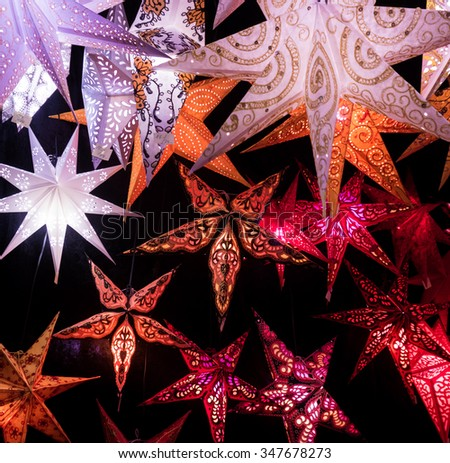 Colorful Christmas stars.  A background of star lanterns.