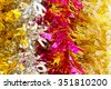Colorful christmas tinsel texture and background - stock photo