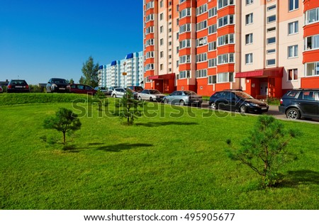 colorful city buildings with green lawn