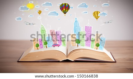 Colorful cityscape drawing on open book - stock photo