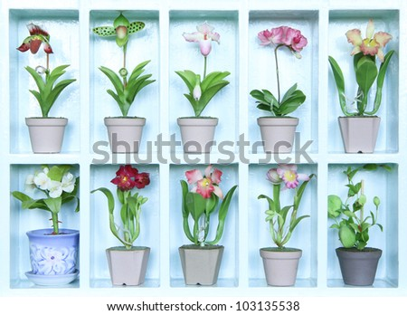 Colorful clay flower in flower cabinet - stock photo